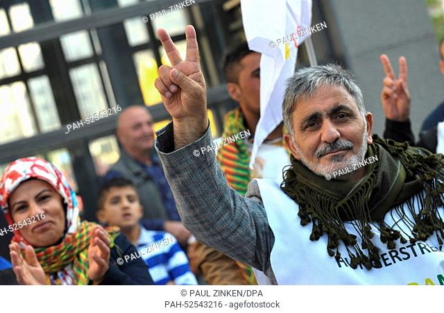 Kurds making the victory sign at a Kurdish demonstration at Potsdamer Platz in Berlin, Germany, 4 October, 2014. Police estimate around 1