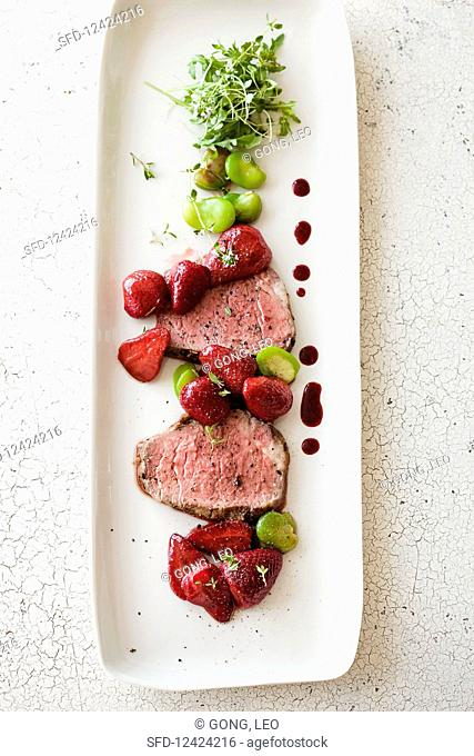 Sliced beef tenderloin with caramelized strawberries