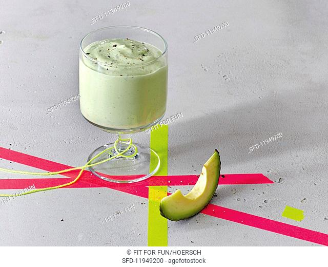 Avocado smoothie with herbs and hemp seeds