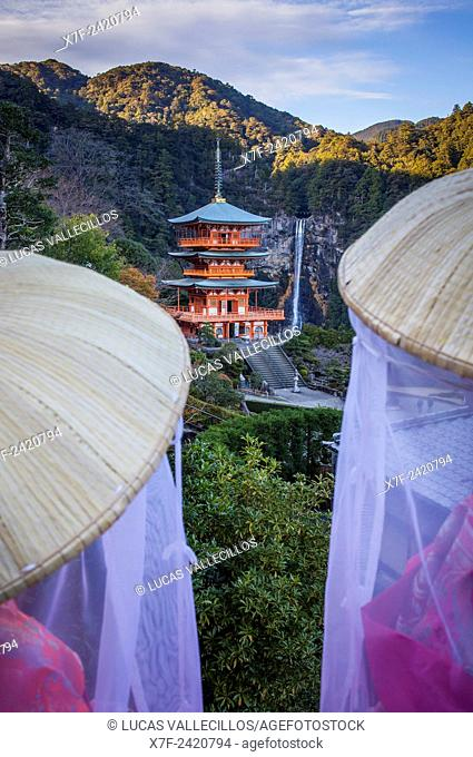 Pilgrims in Heian period costumes and Nachisan Seiganto-ji Temple (Three-Storied Pagoda), near Kumano Nachi Taisha Grand Shire, Kumano Kodo, Nakahechi route