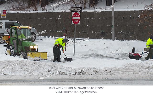 WHITE PLAINS, NY - FEBRUARY 5: Department of Public Works workers clear a municipal parking lot and sidewalks after a heavy snowfall on February 5