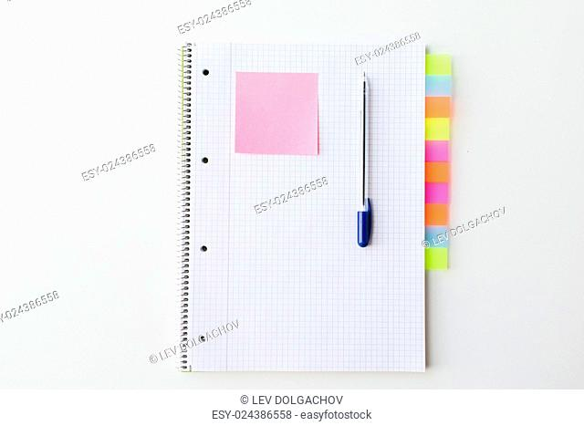business, information, memo, management and education concept - close up of notebook or organizer with tags and pen on office table
