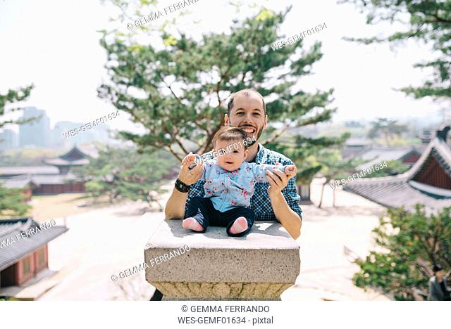 South Korea, Seoul, Father and baby girl visiting Changdeokgung Palace and Huwon