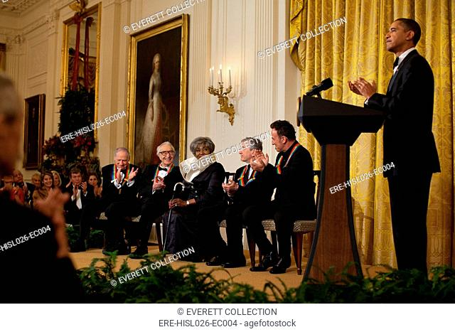 President Obama applauds Kennedy Center Honors recipients in the White House East Room. Seated on stage are Mel Brooks Dave Brubeck Grace Bumbry Robert De Niro...