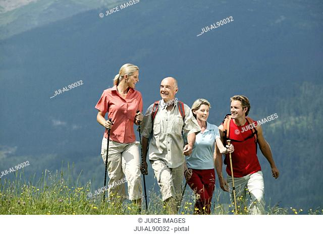Group of people hiking, Kleinwalsertal, Allgau, Germany