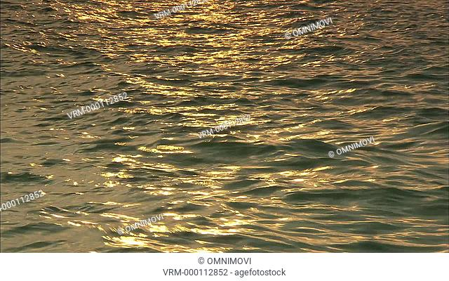 CU FO Sun reflecting on water / Venice, Italy