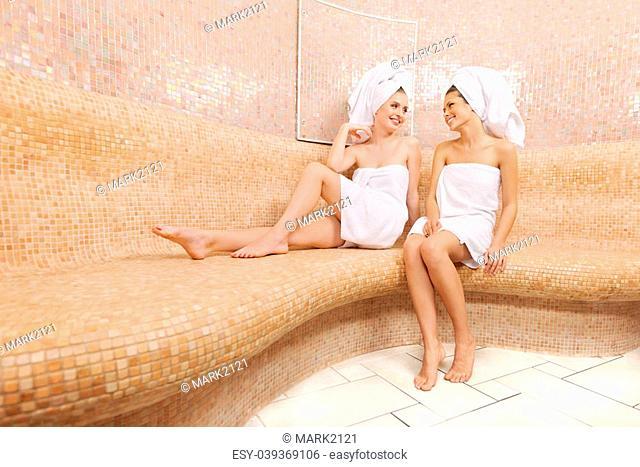 Two attractive girl friends in Turkish sauna