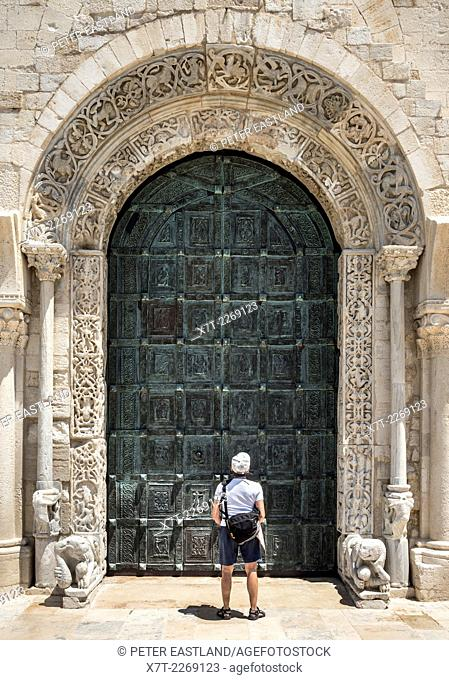 The carved romanesque surround and bronze doors to The 12th century romanesque Cathedral at Trani, Puglia, Southern Italy