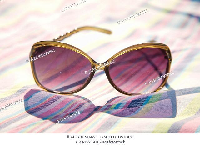 Sunglasses on a stripy towel