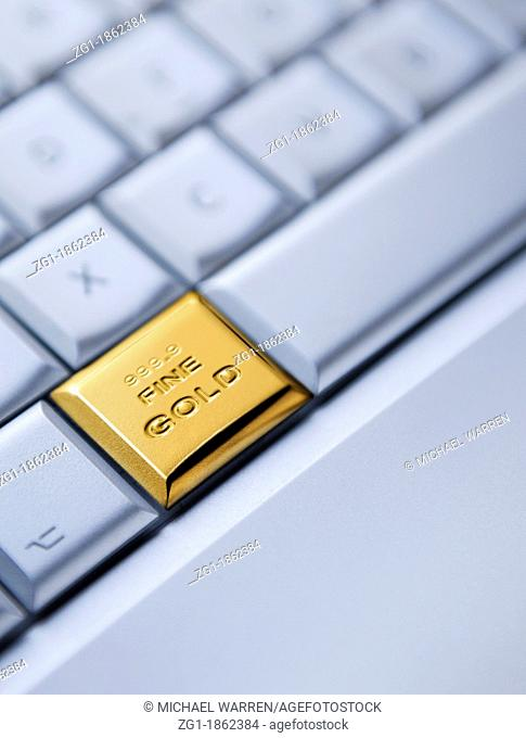 Detail of a keyboard with one key as a solid gold bar