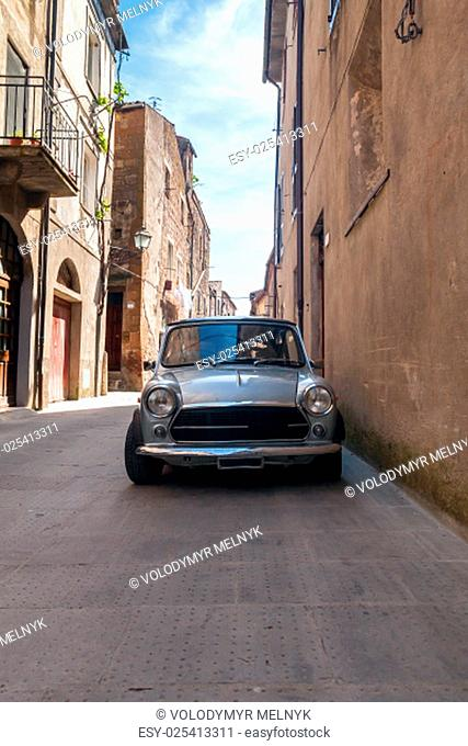 old retro car in the narrow streets of the old Italian city