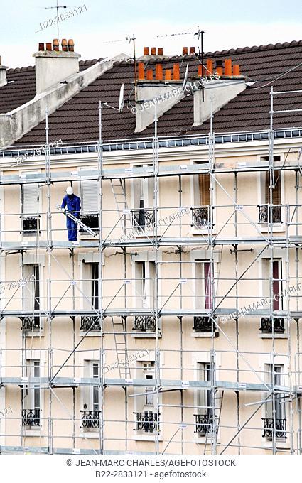 Suspended scaffolding structure for works in facade. Saint-Denis, northern suburbs of Paris, Seine-Saint-Denis, Ile de France, France