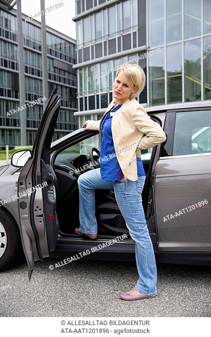 Female car driver has backache