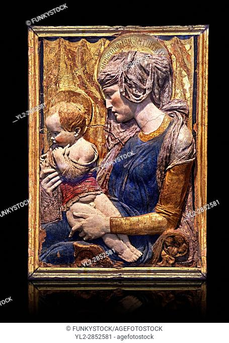 Painted terracotta relief panel depicting the Virgin and Child by Niccolo Bardi better known as Donatello. Made in Florence around 1386
