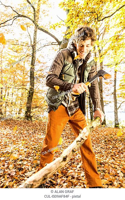 Man chopping log with axe