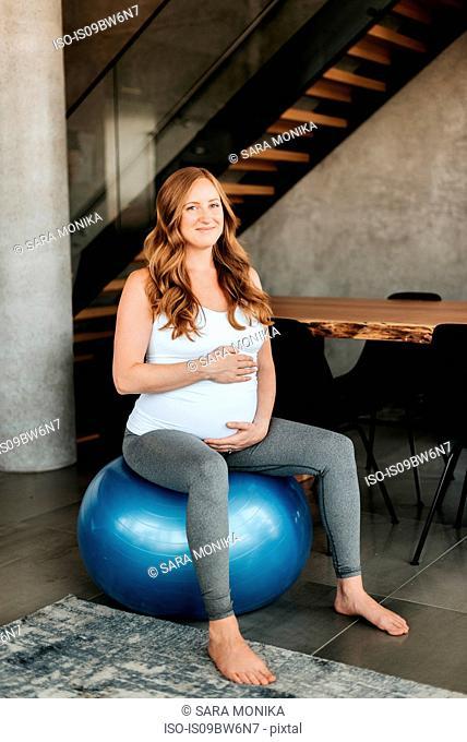 Pregnant woman on exercise ball