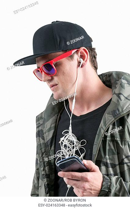 Man with tangled headphones
