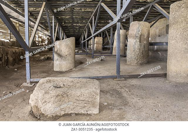 Stones with holes to fit in the rigging system at Roman theatre of Medellin, Spain