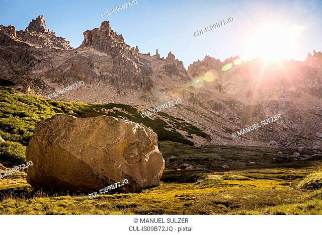 Boulder in sunlit mountain valley, Nahuel Huapi National Park, Rio Negro, Argentina