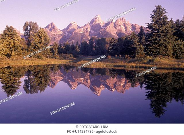 Grand Teton National Park, WY, Snake River, Jackson Hole, Wyoming, Scenic view of the Grand Teton Mountains reflecting in the calm waters of the Snake River at...