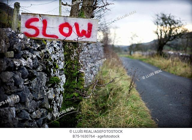 SLOW signal handwritten Road in Yorkshire Dales, England, UK