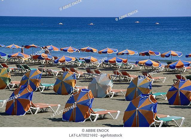 Rows Of Umbrellas Sunbeds Sandy Beach Sea Identical