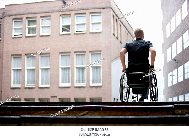 Rear view of man in wheelchair