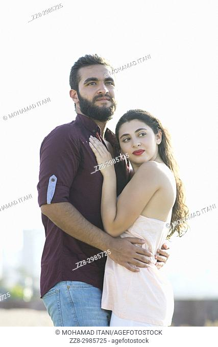Young Middle Eastern couple outdoors