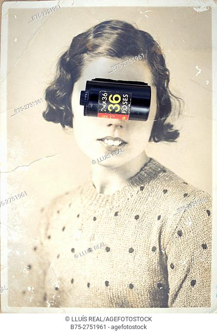 Old black and white portrait of woman looking at camera with 35 mm film roll (36 poses) on her eyes