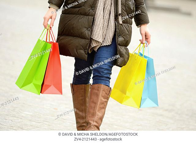 Close-up of a woman holding shopping bags in her hand