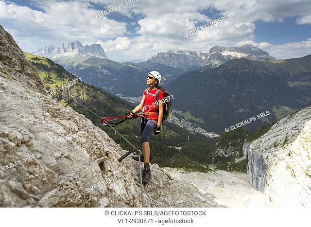 a climber looking the Panorama during a via ferrata, Trento province, Trentino Alto Adige. Italy,