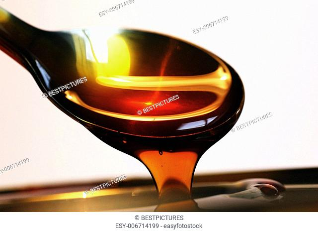 Golden Honey On Spoon