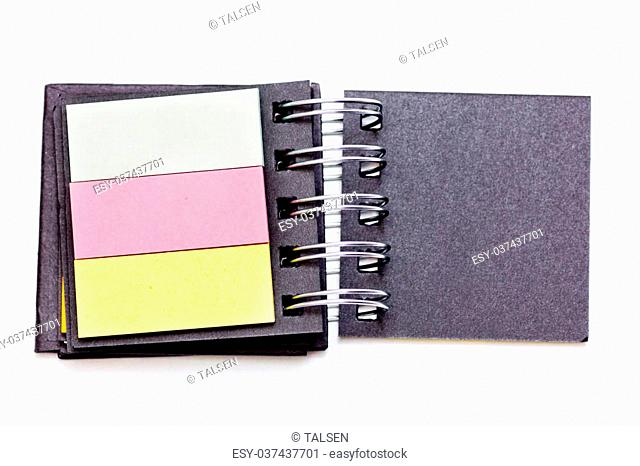 An empty open coloured notebook