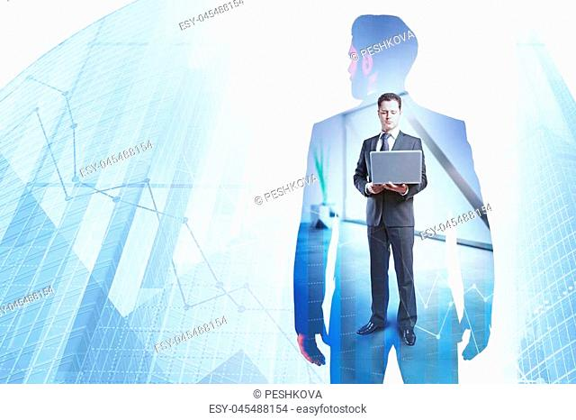 Businessman using laptop on abstract city background with forex chart and copy space. Innovation and communication concept. Double exposure