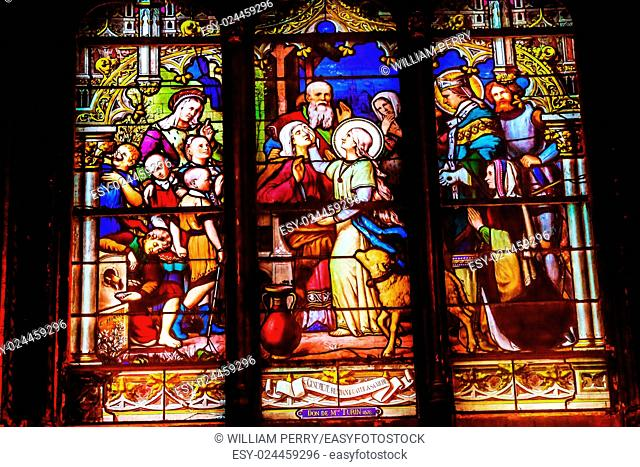Saint Genevieve, Patron Saint of Paris, Stained Glass Saint Severin Church Paris France. Saint Genevieve lived in Paris between 400 to 512AD