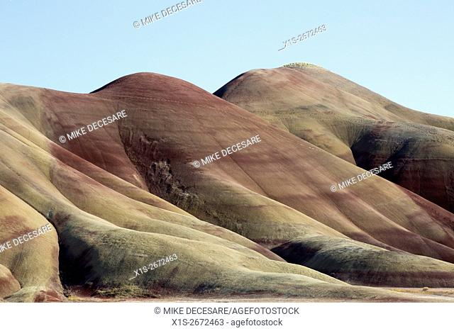 Long sloping lines of multi colored volcanic clay and ash seem other worldly in the landscape of the Painted Hills in East Central Oregon