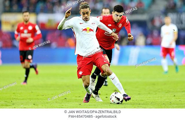 Leipzig's Yussuf Poulsen with the ball during the Bundesliga soccer match between RB Leipzig and FSV Mainz 05 at the Red Bull Arena in Leipzig, Germany