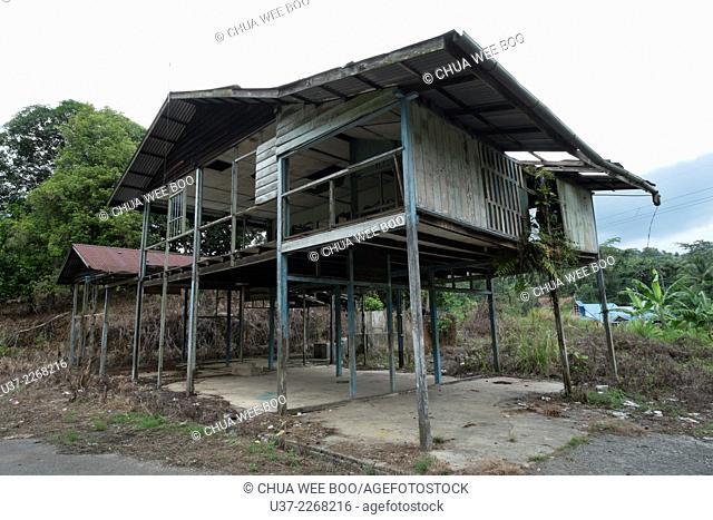 An abandoned wooden Bidayuh house in Kampung Bengoh, Sarawak, Malaysia