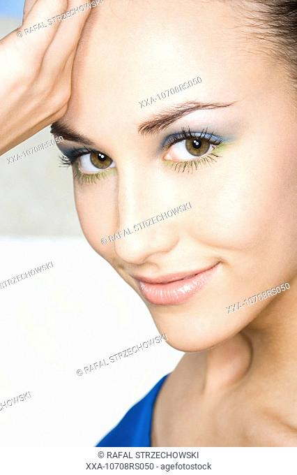 young woman with blue make-up