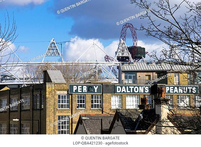 England, London, Stratford. The former Percy Dalton Peanut factory with the top of the Olympic stadium and ArcelorMittal Orbit visible in the background