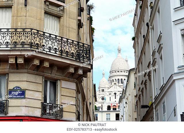 Sacre Coeur down street in Paris, France