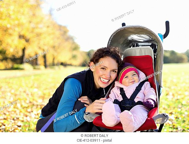 Woman smiling with baby in stroller