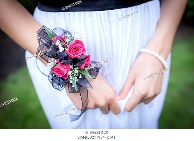 Close up of teenage girl in prom attire wearing corsage