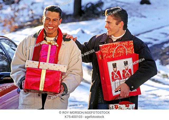 Male couple with Christmas presents