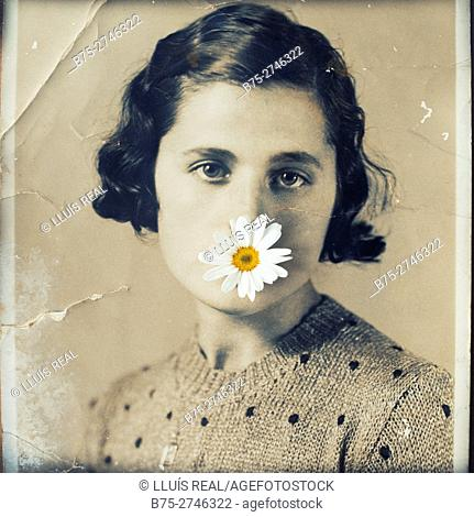 Antique portrait of young woman looking at the camera, with a white and  yellow daisy in her mouth