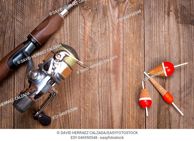 Fishing tackle on wooden background. Accesories for fishing with copyspace