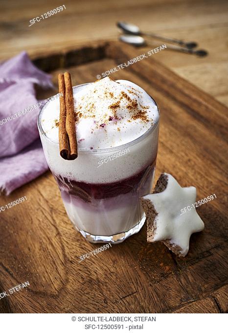 Mulled wine macchiato with milk foam and a cinnamon star