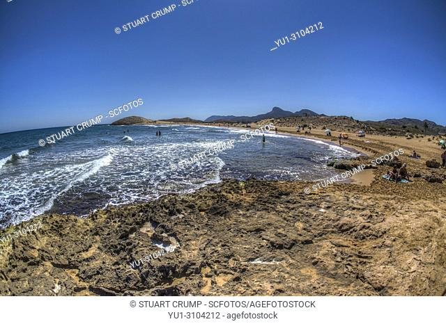 HDR image of the Mediteranean sea and the public beach at Calblanque in Murcia Spain