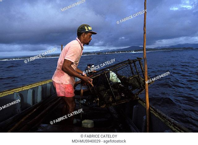 Fishermen with fish pots or traps behind the barrier reef