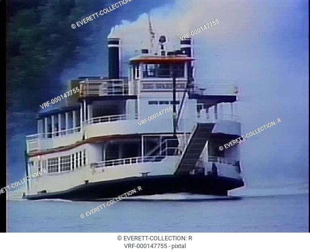 Steam boat traveling on river